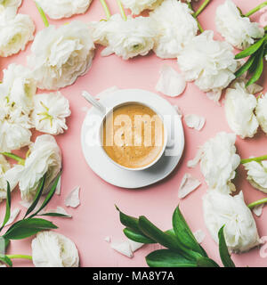 Cup of coffee and ranunculus flowers on light pink background - Stock Photo