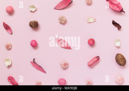 Creative pattern made of dried flowers, leaves and fruitage on pastel pink background summer spring minimal concepts. - Stock Photo