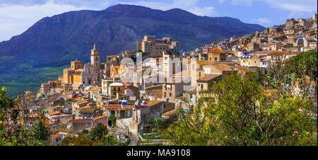 Impressive Caccamo village,view with houses,old castle an mountains,Sicily,italy. - Stock Photo