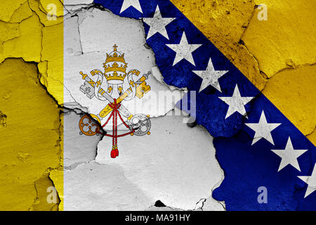 flags of Vatican and Bosnia and Herzegovina painted on cracked wall - Stock Photo
