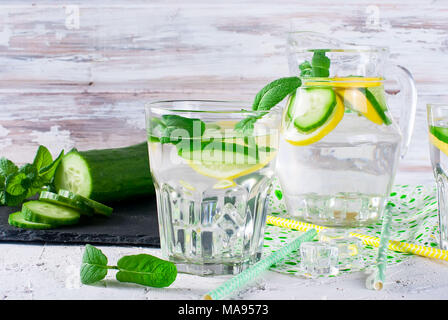 Refreshing cucumber cocktail, lemonade, detox water in a glasses on a white background. Summer drink. - Stock Photo
