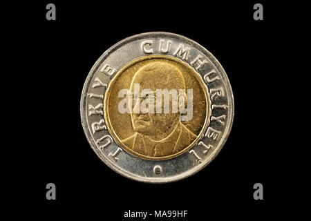 A macro image of a bimetallic 1 Turkish Lira coin isolated on a black background - Stock Photo
