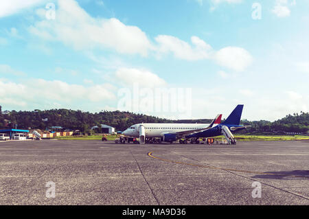 passenger plane parked at the airport, wait for boarding, at morning. Preparation of the aircraft before flight. Checking the airliner after the fligh - Stock Photo