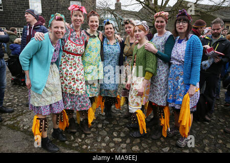 Heptonstall, UK. 30th March, 2018. Female Morris Dancers in Weavers Square on Good Friday in the historical village of Heptonstall, 30th March, 2018 (C)Barbara Cook/Alamy Live News - Stock Photo