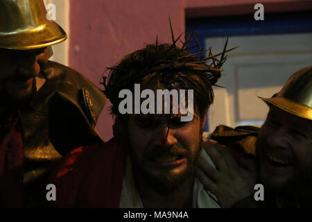 Living Via Crucis is represented in the Loma de San Jeronimo neighborhood, in Asuncion, Paraguay, 30 March 2018. The passion of Christ and the agony of his crucifixion were represented today in the neighborhood of Loma de San Jeronimo in the most popular Way of the Cross of Asuncion in a living representation in which they took part, characterized as 'estacioneros', the brothers who maintain a tradition of almost a century ago. EFE/Alberto Pena - Stock Photo