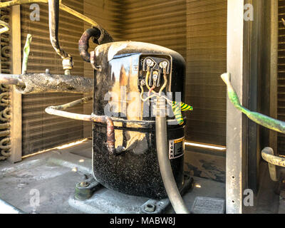 closeup of a shining compressor after cleaning service fixed into a heavy duty air conditioning system kept on the roof it was serviced by professiona - Stock Photo