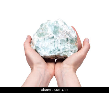 Woman's hand holding raw green apophyllite cluster isolated on white background - Stock Photo