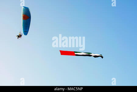 United Arab Emirates flag flying in the air from a - Stock Photo