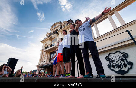 Uzhgorod, Ukraine - Jun 10, 2016: participants of outdoor sports competition. workout championship in Uzhgorod. Young men celebrate their victory - Stock Photo