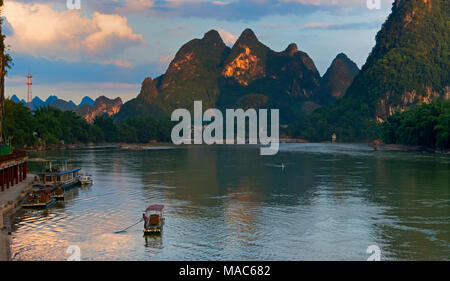 Bamboo raft on Li River with karst hills, Xingping, Yangshuo, Guangxi, China - Stock Photo