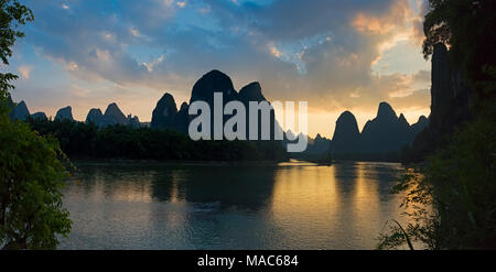 Karst hills with Li River at sunset, Xingping, Guangxi, China - Stock Photo