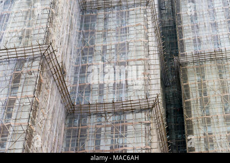 Scaffolding around the residential buildings for renovation in Quarry Bay, Hong Kong, China - Stock Photo