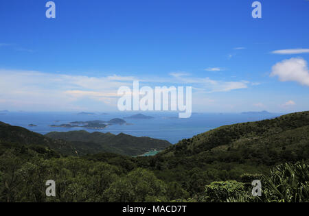 the beautiful weather in summer from Lantau Island to south china sea, with the view of Shek Pik Reservoir in Hong Kong - Stock Photo