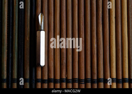 Head for screwdriver (bits) on wooden background, Tools collection turn-screw - Stock Photo