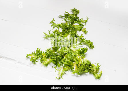 Christmas Food background. Christmas tree made from fresh frise on white background. Healthy holiday food, vegan, vegetarian and diet concept. - Stock Photo