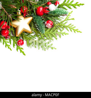 Christmas Background with Red Holly Berries, Xmas Tree Twig and Golden Star on White Background with Copy Space - Stock Photo