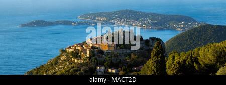 The Village of Eze (Èze), the Mediterranean Sea and Saint-Jean-Cap-Ferrat at sunrise. Alpes-Maritimes, French Riviera, Cote d'Azur, France - Stock Photo