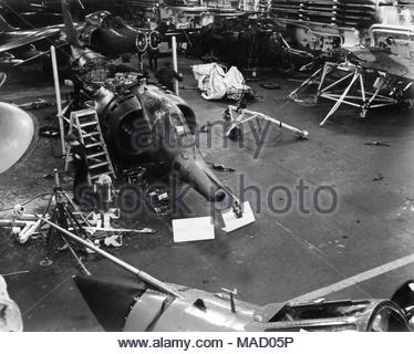 Embargoed to 0001 Sunday April 1 Undated handout photo issued by The Ministry of Defence of a Harrier GR.3 undergoing an engine change in the hangar on HMS Hermes during the Falkland's war, as a collection of images capturing the development of the RAF across the decades has been released by the MoD to mark the centenary of the worldÕs first independent air force. - Stock Photo
