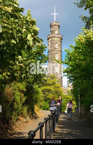 Tourists walk the pathway toward the Admiral Nelson Memorial Tower on Calton Hill, Edinburgh, Lothian, Scotland, UK - Stock Photo