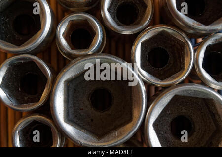 Torx Socket for spanner on wooden background, wrench sockets - Stock Photo