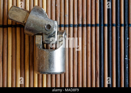 Fastener for Torx Socket for spanner on wooden background - Stock Photo