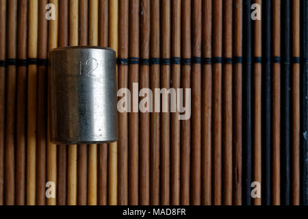 Torx Socket for spanner on wooden background, wrench sockets size is 12 - Stock Photo