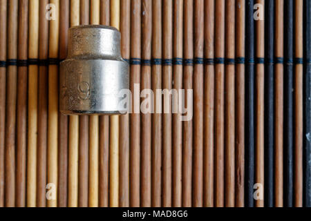 Torx Socket for spanner on wooden background, wrench sockets size is 9 - Stock Photo