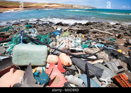 Much of the north side of the island of Molokai in inaccessible. Trade winds blow onshore regularly bringing with them piles of plastic that has been  - Stock Photo