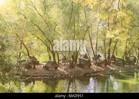 Bird houses in the Moscow zoo in the autumn. - Stock Photo