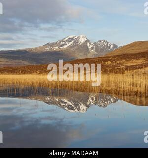 Blaven and reflections in Loch Cill Chriosd taken on a cool crisp springs morning. The sunrise was colourful - Stock Photo