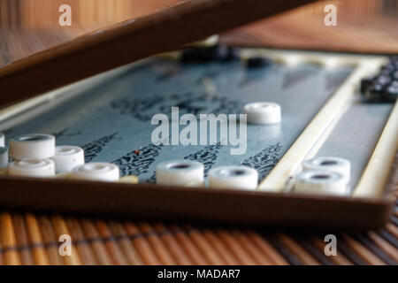 Backgammon opened, mini table game for journey - Stock Photo
