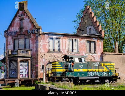 Derelict Brasserie Au Petit Rhin, ruined house, fire damage, burned out roof framework, train diesel locomotive, Strasbourg, Alsace, France, Europe, - Stock Photo