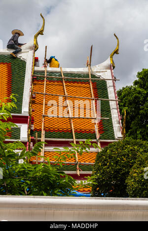 THAILAND – AUGUST 27 Workers repairing roof with bamboo scaffolding,  Wat Pho Buddhist Temple on August 27, 2017 in Bangkok, Thailand - Stock Photo