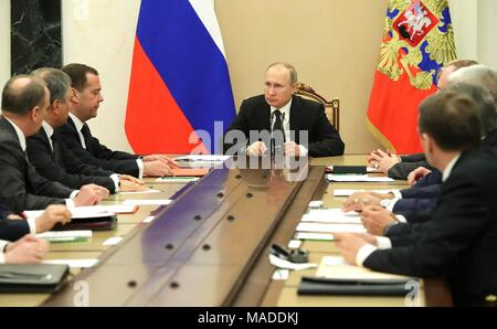 Russian President Vladimir Putin holds a meeting with the permanent members of the Security Council at the Kremlin March 30, 2018 in Moscow, Russia. - Stock Photo