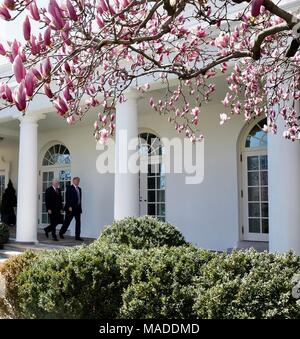 U.S President Donald Trump, right, walks with Vice President Mike Pence through the Colonnade of the White House on a spring day March 23, 2018 in Washington, DC.