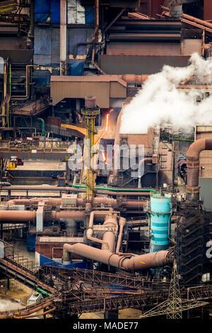 Blast furnace with glowing slag MÖV EV Schwelgern, steel industry, heavy industry, Marxloh, ThyssenSteel, in Duisburg in North Rhine-Westphalia. Duisb - Stock Photo