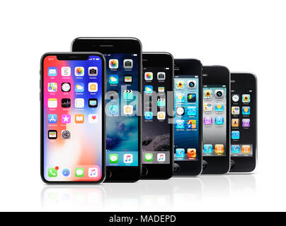 Apple iPhone line-up, iPhone X, 7 plus, 7, 5s, 4, 3, from newer to older models of previous smartphone generations, isolated on white studio backgroun - Stock Photo