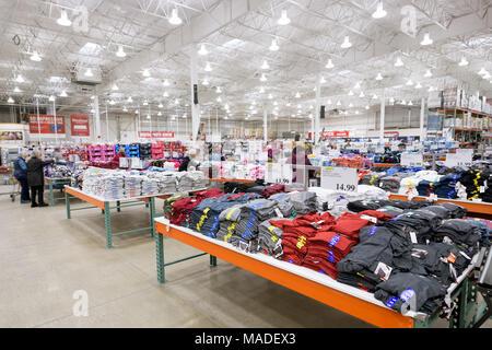Costco Wholesale membership warehouse store interior, T-shirts at the mens clothing section. British Columbia, Canada 2017. - Stock Photo