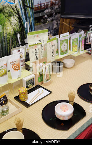 Organic Uji Matcha tea of different grades and a bowl cup with a whisk for matcha sampling ceremony in a store in Uji, Kyoto Prefecture, Japan - Stock Photo
