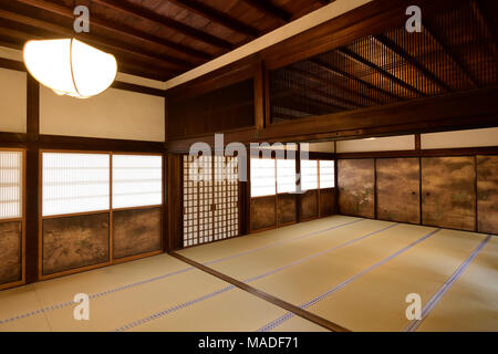 Traditional Japanese temple hall interior with tatami mats and painted shoji sliding screens. Sanboin Buddhist temple, sub-temple of Daigoji complex i - Stock Photo