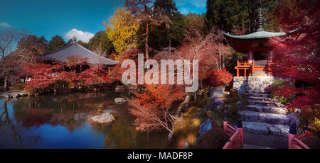 Bentendo Hall with a pond and Daikodo Hall in the background at Daigo-ji temple, in a beautiful panoramic autumn scenery. Shimo-Daigo part of Daigoji  - Stock Photo