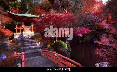 Bridge leading to Bentendo Hall over a pond with Zen garden at Daigo-ji temple in a beautiful autumn scenery. Shimo-Daigo part of Daigoji complex in b Stock Photo
