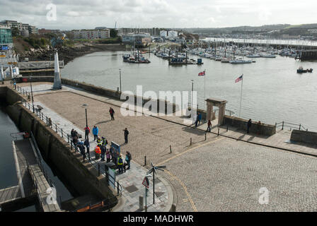 View from above. Barbican, Plymouth showing historic canopy commemorating the Pilgrims journey on the Mayflower to America 1620. sunny, sea background - Stock Photo
