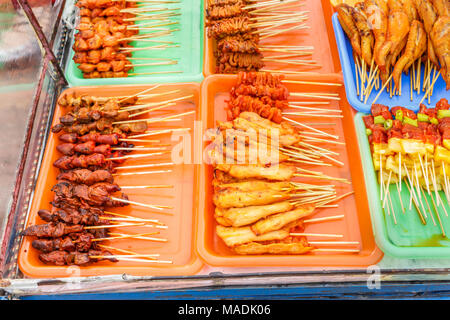 Grilled chicken on the stove, street food in Thailand. - Stock Photo