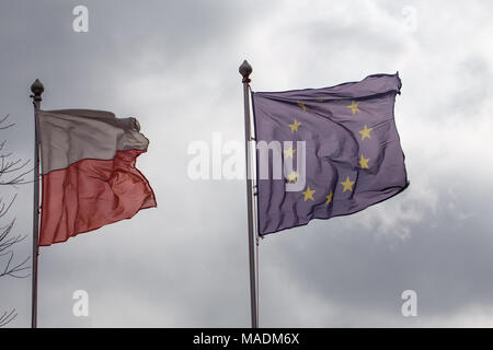 Polish flags and European Union against a cloudy sky. concept of perishable - Stock Photo