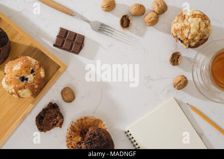 Breakfast with fresh homemade delicious muffins and tea. - Stock Photo