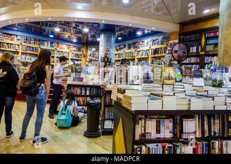 Buenos Aires Argentina Recoleta Mall shopping interior Libreria Cuspide Books bookstore retail display tables boy girl teen Hispanic Argentinean Argen - Stock Photo