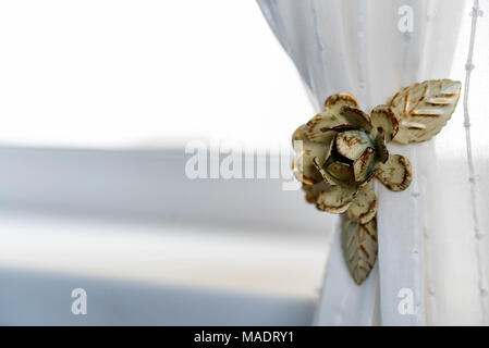 Decorative curtain clip in shape of flower - Stock Photo