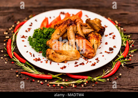 Chicken wings grilled with spices and chili pepper - Stock Photo