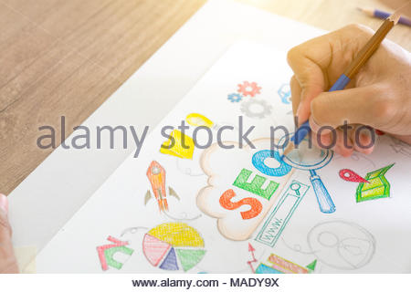 Seo concept drawn on a notepad - Stock Photo
